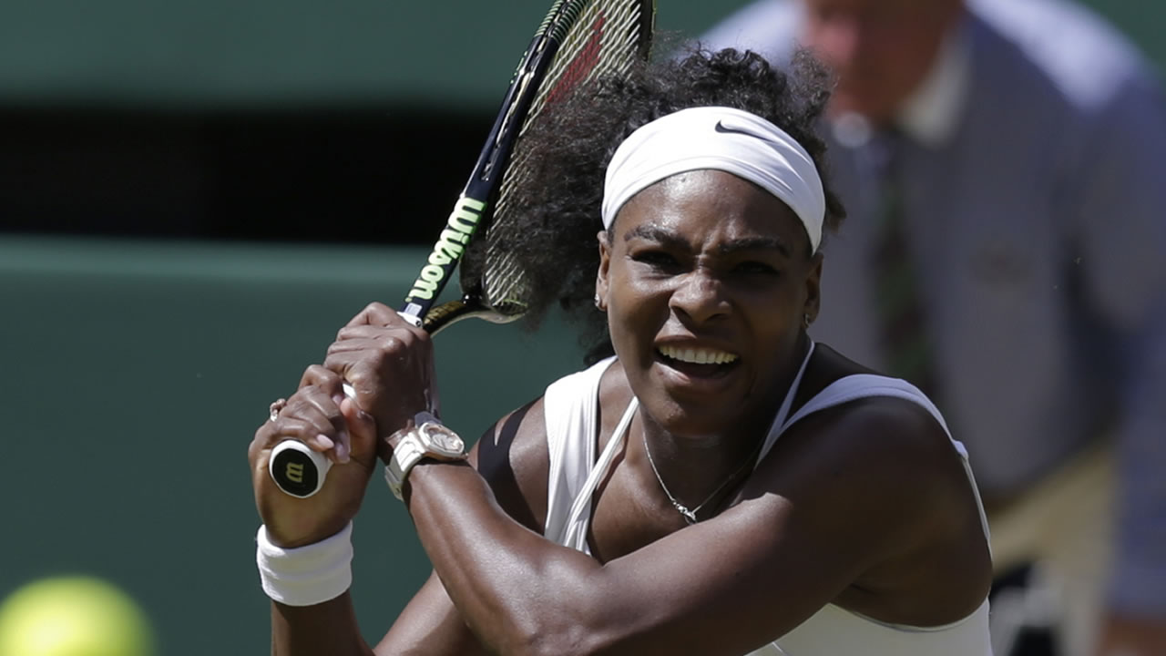 Serena Williams returns a shot to Garbine Muguruza of Spain during the women's singles final in Wimbledon, London, Saturday July 11, 2015.