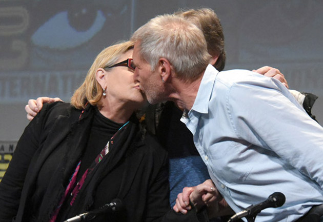 "<div class=""meta image-caption""><div class=""origin-logo origin-image none""><span>none</span></div><span class=""caption-text"">Carrie Fisher and Harrison Ford kiss at the Lucasfilm's ""Star Wars: The Force Awakens"" panel on day 2 of Comic-Con International on Friday, July 10, 2015, in San Diego, Calif. (Photo by Richard Shotwell/Invision/AP)</span></div>"