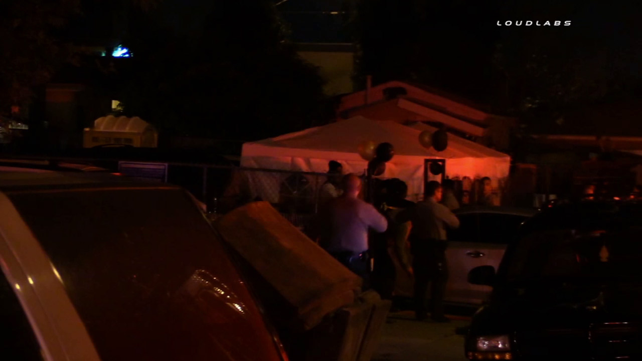 Authorities investigate a party in West Athens where one man was killed and two others wounded in a shooting on Saturday, July 11, 2015.