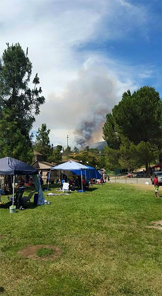 "<div class=""meta image-caption""><div class=""origin-logo origin-image none""><span>none</span></div><span class=""caption-text"">Smoke rises into the sky after a brush fire broke out in the San Bernardino National Forest on Sunday, July 12, 2015. (Rigo Guardado)</span></div>"