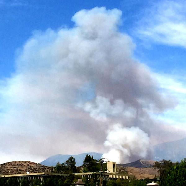 "<div class=""meta image-caption""><div class=""origin-logo origin-image none""><span>none</span></div><span class=""caption-text"">Smoke rises into the sky after a brush fire broke out in the San Bernardino National Forest on Sunday, July 12, 2015. (San Bernardino County Fire Department)</span></div>"
