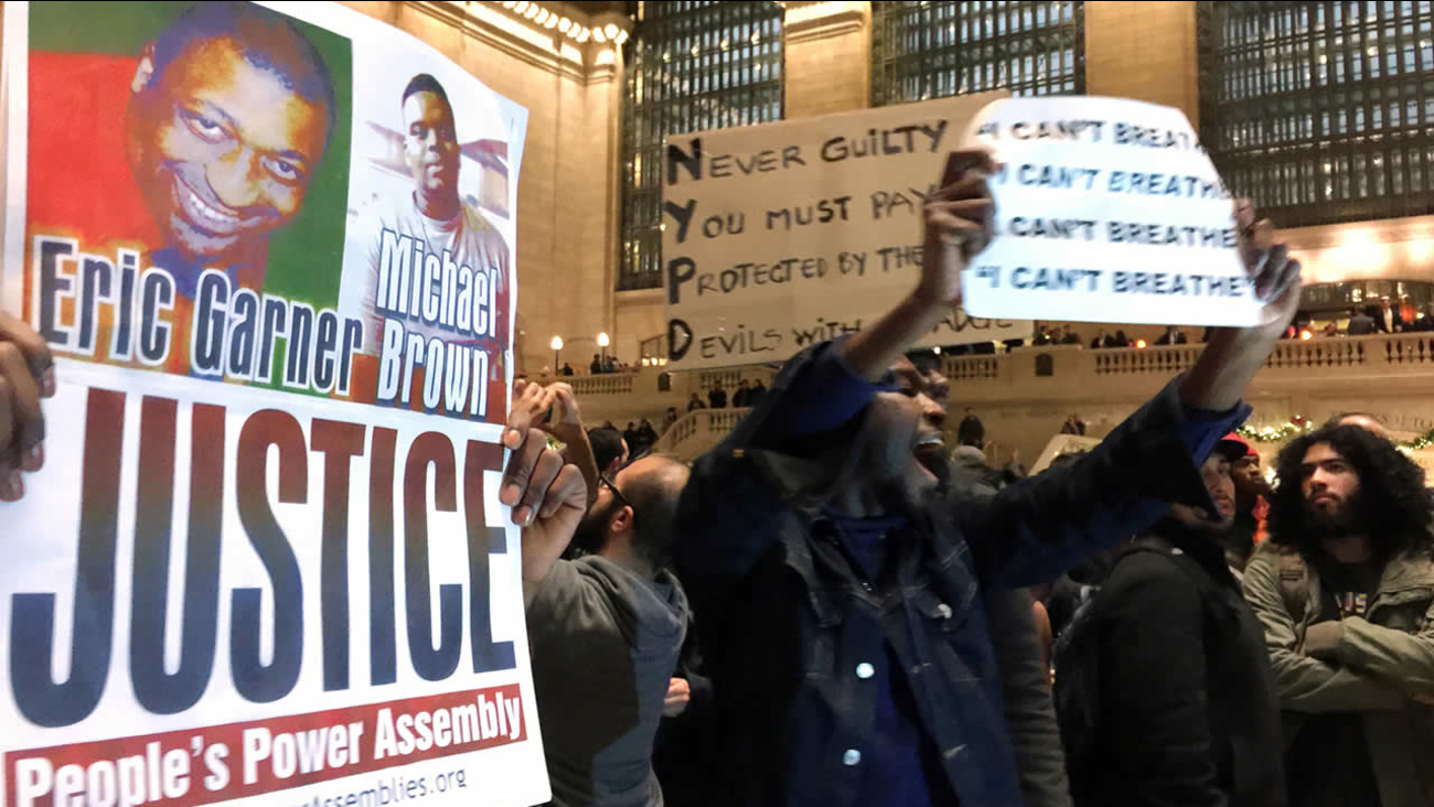 In this Dec. 3, 2014, photo, people gather in New York's Grand Central Terminal to protest the death of Eric Garner. (AP Photo/Jaime Holguin, File)