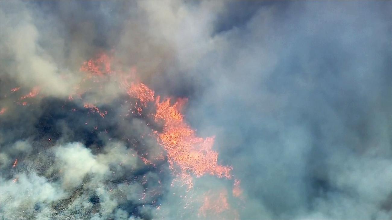 A brush fire ignited near Irvine Lake on Monday, July 13, 2015.