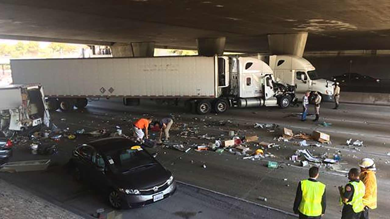 Pasadena firefighters respond to a collision involving a big rig, a truck and a vehicle near Lake Avenue in Pasadena Tuesday, July 14, 2015.