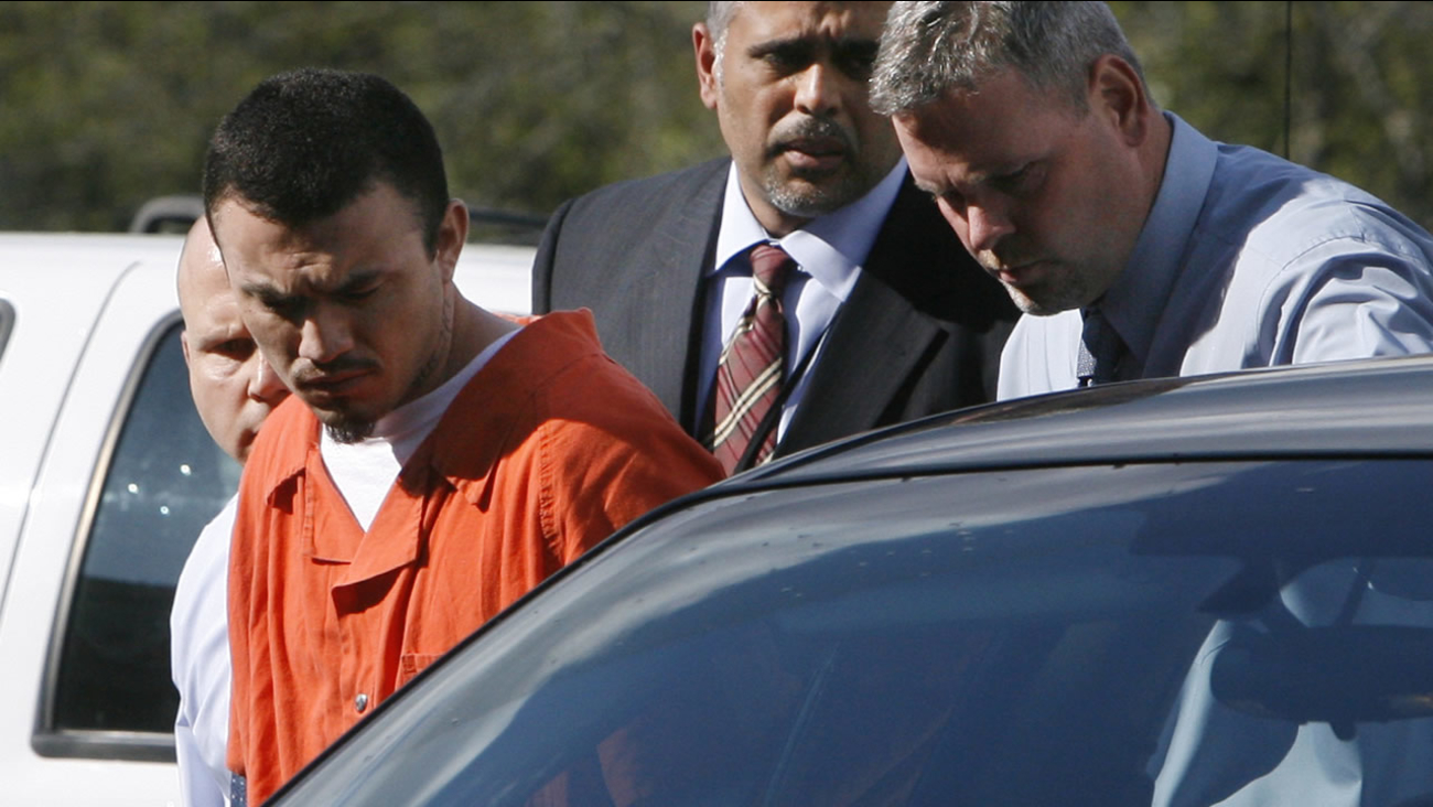 Ingmar Guandique, 27, left, who is accused of killing Chandra Levy, is escorted into the Violent Crimes Unit by detectives in Washington, on Wednesday, April 22, 2009.