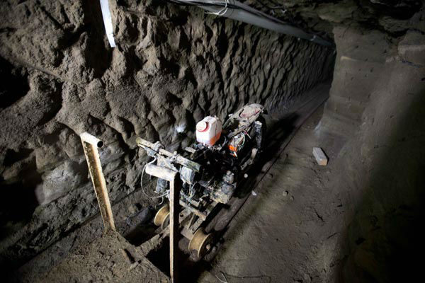 "<div class=""meta image-caption""><div class=""origin-logo origin-image none""><span>none</span></div><span class=""caption-text"">A motorcycle adapted to a rail sits in the tunnel under the half-built house where according to authorities, drug lord Joaquin ""El Chapo"" Guzman made his escape (AP Photo/ Eduardo Verdugo)</span></div>"