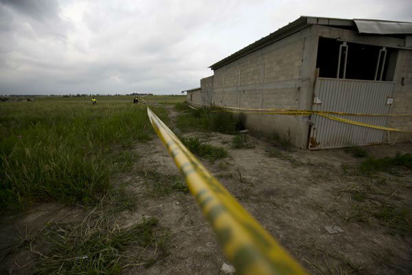 "<div class=""meta image-caption""><div class=""origin-logo origin-image none""><span>none</span></div><span class=""caption-text"">Yellow police tape surrounds the construction site where the exit of the tunnel, they claim was used by drug lord Joaquin ""El Chapo"" Guzman to break out of prison. (AP Photo/ Eduardo Verdugo)</span></div>"