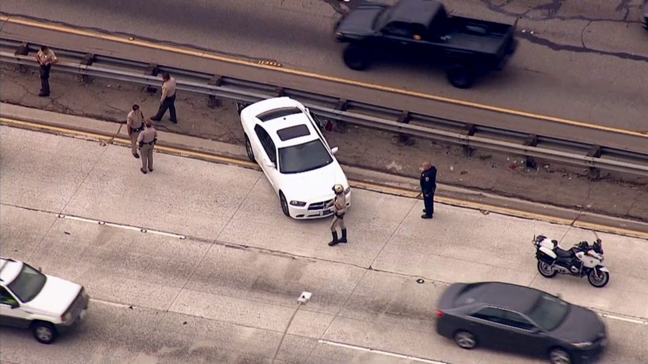 Deputies clear the scene at the end of a police chase on the 10 Freeway in the Pomona area on Wednesday, July 15, 2015.