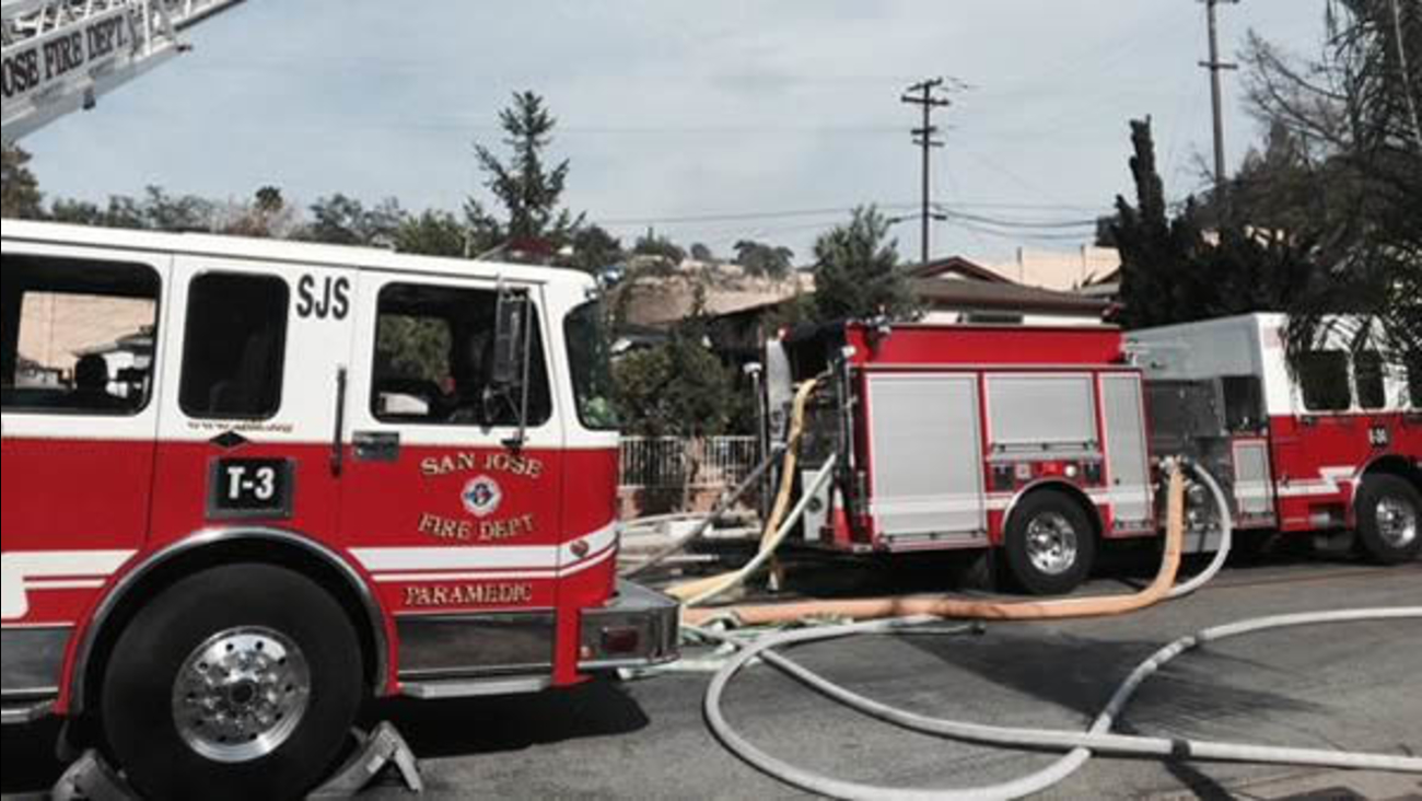 Crews battle a fire at a home on Snow Drive in San Jose on Sunday, July 12, 2015.