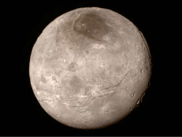 """<div class=""""meta image-caption""""><div class=""""origin-logo origin-image none""""><span>none</span></div><span class=""""caption-text"""">This Tuesday, July 14, 2015 image provided by NASA on Wednesday shows Pluto's largest moon, Charon, made by the New Horizons spacecraft. (NASA/JHUAPL/SwRI via AP)</span></div>"""