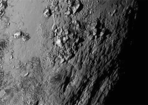 "<div class=""meta image-caption""><div class=""origin-logo origin-image none""><span>none</span></div><span class=""caption-text"">This Tuesday, July 14, 2015 image provided by NASA on Wednesday shows a region near Pluto's equator with a range of mountains captured by the New Horizons spacecraft. (AP Photo/  PDS **NY**)</span></div>"