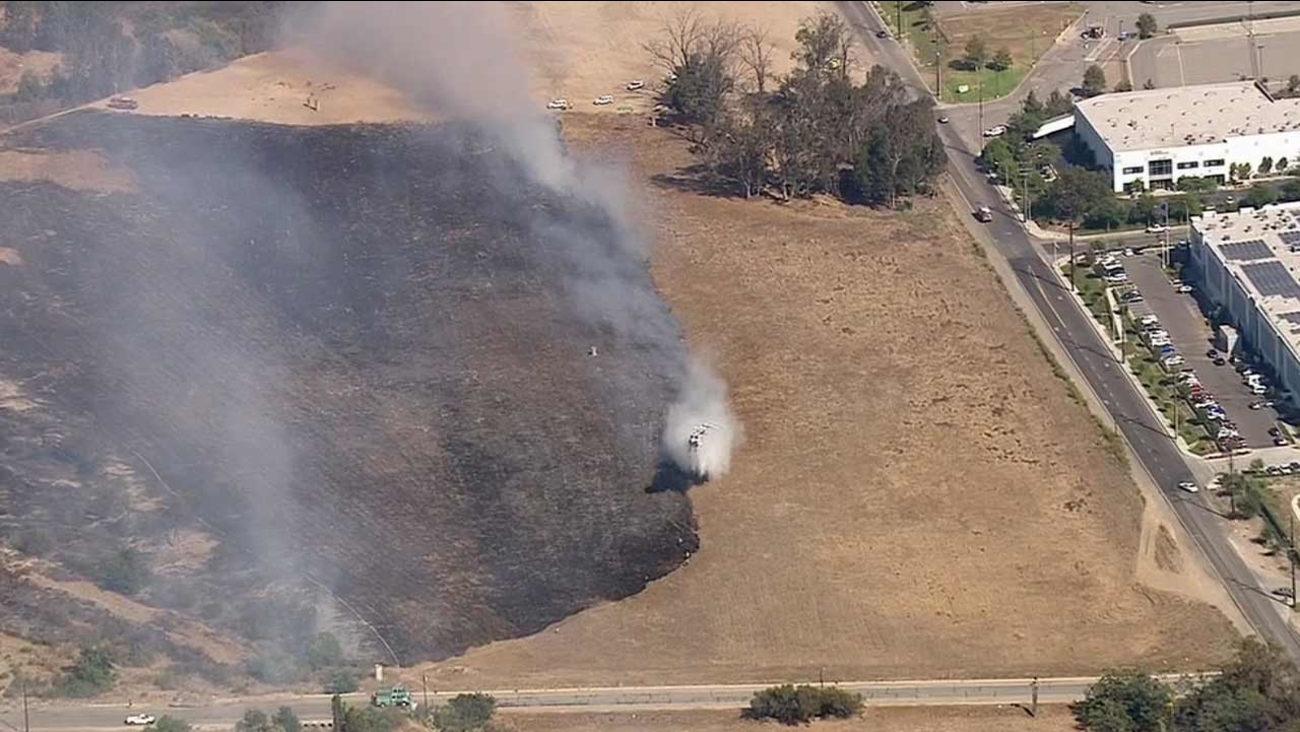A brush fire erupted at the Temescal Wash near Rincon and Auburndale streets in Corona Wednesday, July 15, 2015.