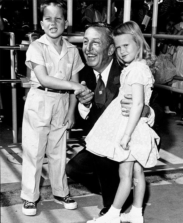 "<div class=""meta image-caption""><div class=""origin-logo origin-image none""><span>none</span></div><span class=""caption-text"">In this handout file photo from Disneyland, Walt Disney poses with the first two visitors, Michael Schwartner, 7, left, and Christine Vess, 5, right, on the park's opening day. (Photo/AP)</span></div>"
