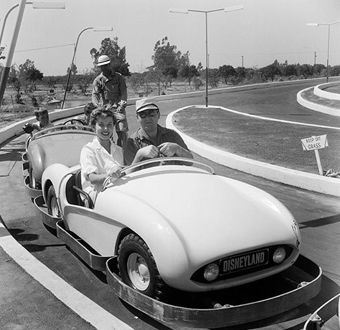 "<div class=""meta image-caption""><div class=""origin-logo origin-image none""><span>none</span></div><span class=""caption-text"">Actress Adelle August poses as she rides on Autopia during the opening day of Disneyland in Anaheim, Calif. (Earl Leaf/Michael Ochs Archives/Getty)</span></div>"