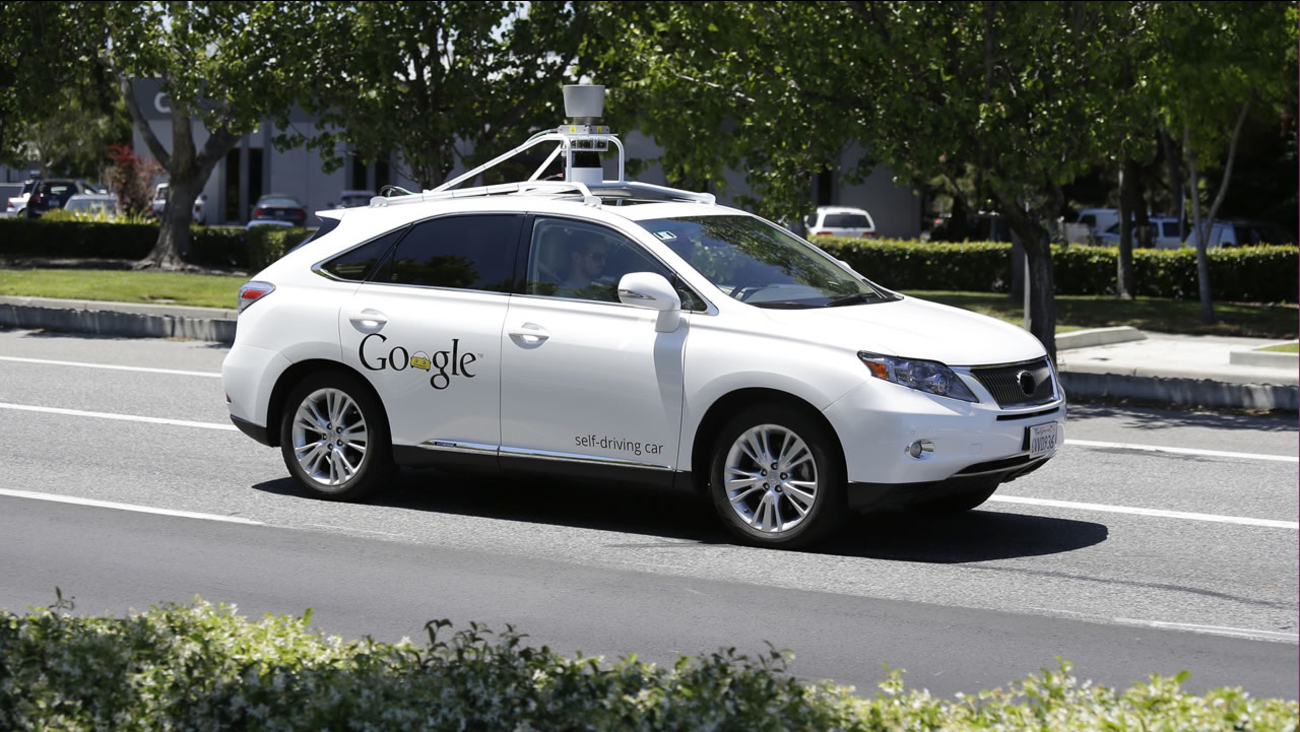 In this May 13, 2014, file photo, a Google self-driving car goes on a test drive near the Computer History Museum in Mountain View, Calif.