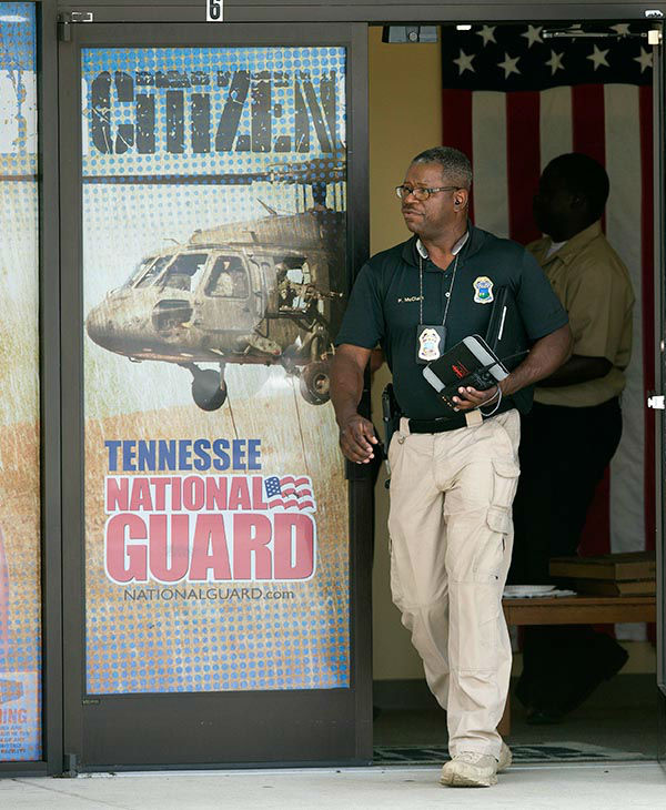 """<div class=""""meta image-caption""""><div class=""""origin-logo origin-image none""""><span>none</span></div><span class=""""caption-text"""">A police officer investigates outside the Armed Forces Career Center after a gunman opened fire on the building Thursday, July 16, 2015, in Chattanooga, Tenn. (AP)</span></div>"""