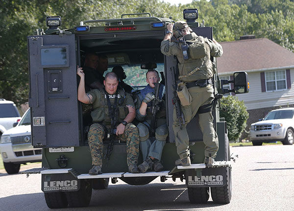 """<div class=""""meta image-caption""""><div class=""""origin-logo origin-image none""""><span>none</span></div><span class=""""caption-text"""">Members of a SWAT team sit on the back of a vehicle in Hixson, Tenn., Thursday, July 16, 2015. (AP)</span></div>"""