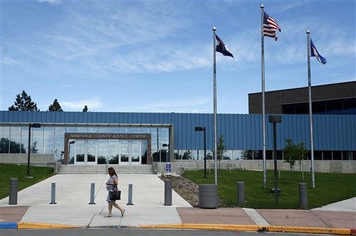 """<div class=""""meta image-caption""""><div class=""""origin-logo origin-image none""""><span>none</span></div><span class=""""caption-text"""">A woman walks past the entrance to the Arapahoe County District Court on the day of closing arguments (AP Photo/ Brennan Linsley)</span></div>"""