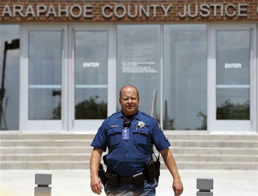 """<div class=""""meta image-caption""""><div class=""""origin-logo origin-image none""""><span>none</span></div><span class=""""caption-text"""">A police officer walks near the entrance to the Arapahoe County District Court on the day of closing arguments (AP Photo/ Brennan Linsley)</span></div>"""