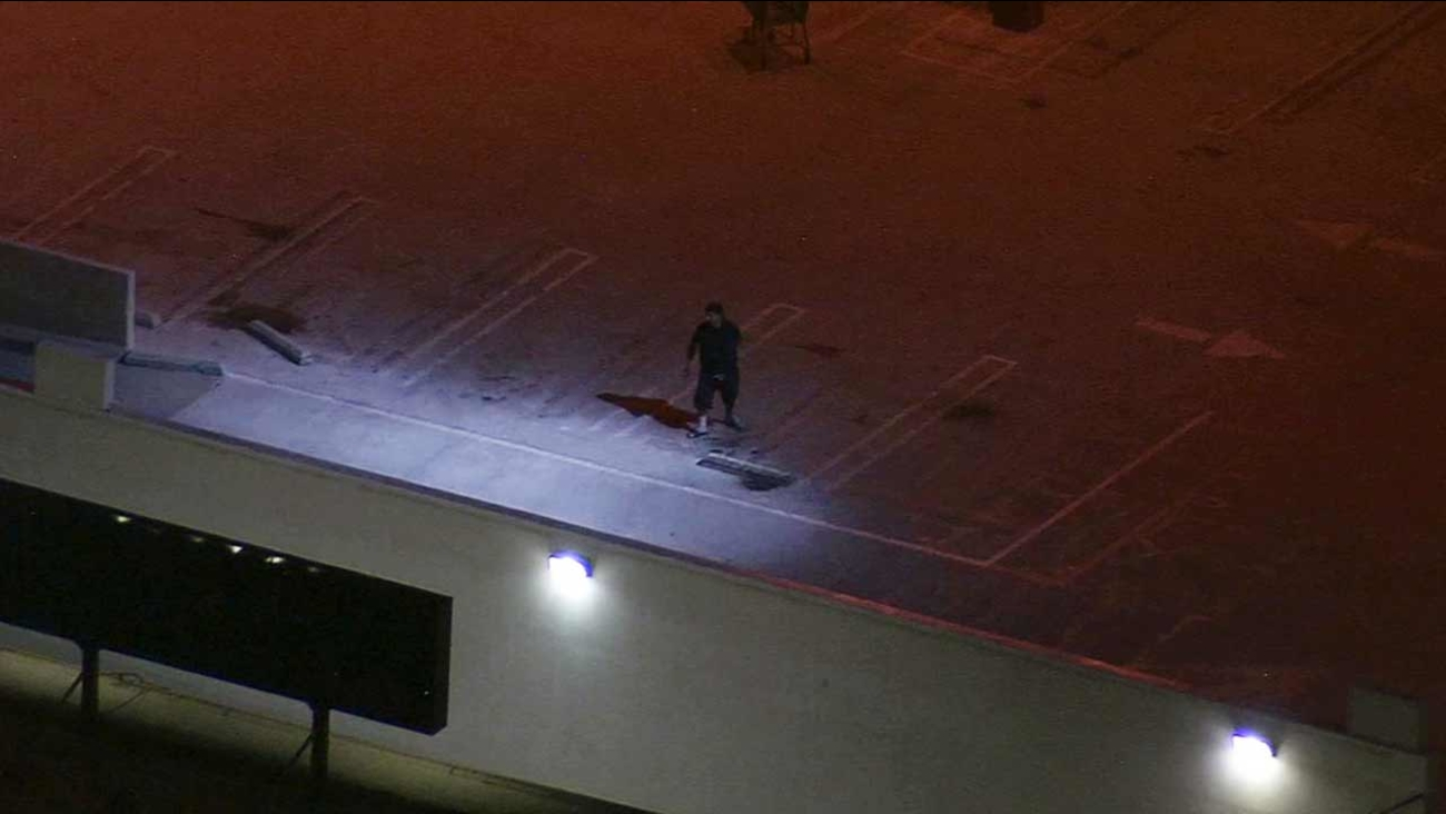 An armed man held police at bay at a parking structure in the 3100 block of South Sepulveda Boulevard in the Palms neighborhood of Los Angeles Thursday, July 16, 2015.