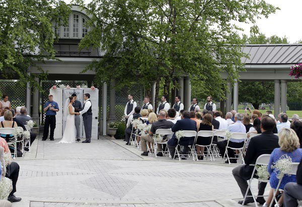 """<div class=""""meta image-caption""""><div class=""""origin-logo origin-image none""""><span>none</span></div><span class=""""caption-text"""">In this June 19, 2015 photo, Danessa Molinder and Billy Castrodale get married in the open air courtyard at the Community Life Center, in Indianapolis. (AP Photo/ Darron Cummings)</span></div>"""