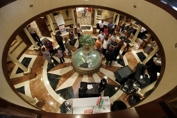 """<div class=""""meta image-caption""""><div class=""""origin-logo origin-image none""""><span>none</span></div><span class=""""caption-text"""">In this June 19, 2015 photo, guests gather in the rotunda as they wait for the wedding of Danessa Molinder and Billy Castrodale at the Community Life Center, in Indianapolis. (AP Photo/ Darron Cummings)</span></div>"""