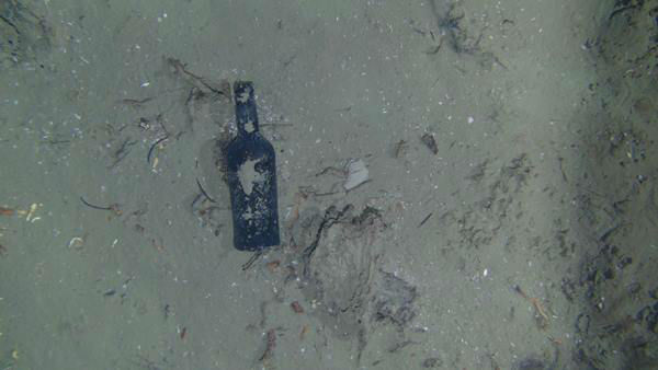 "<div class=""meta image-caption""><div class=""origin-logo origin-image none""><span>none</span></div><span class=""caption-text"">One of nine glass bottles observed at the site of a centuries-old shipwreck off the North Carolina coast. (credit: WHOI)</span></div>"