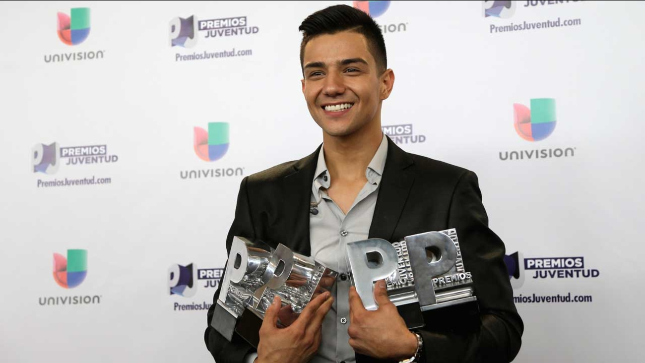Luis Coronel poses with his four awards backstage at the Premios Juventud 2015, Thursday, July 16, 2015, in Coral Gables, Fla. (AP Photo/Lynne Sladky)