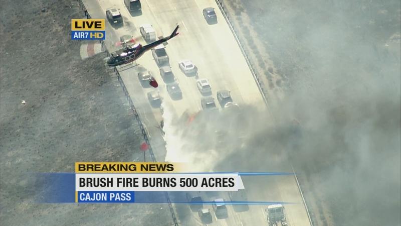 VIDEO: North Fire sweeps across 15 Freeway, burns cars