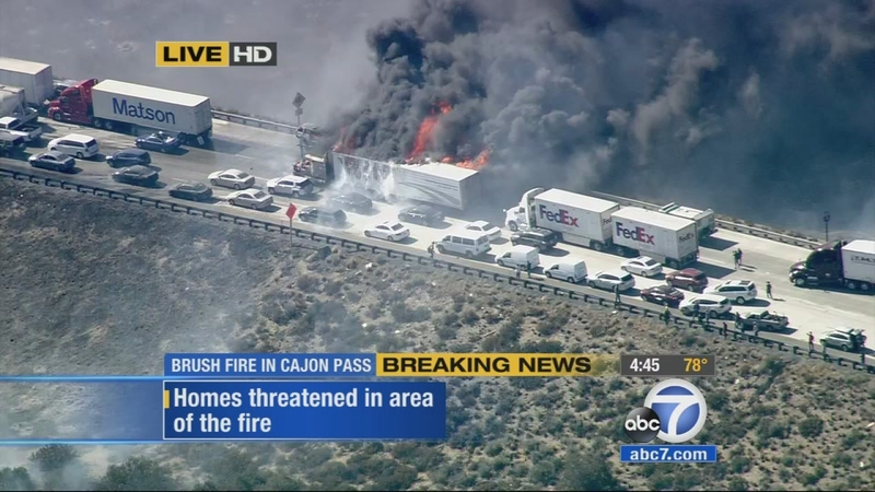 VIDEO: Flames engulf big rig on 15 Freeway as North Fire spreads