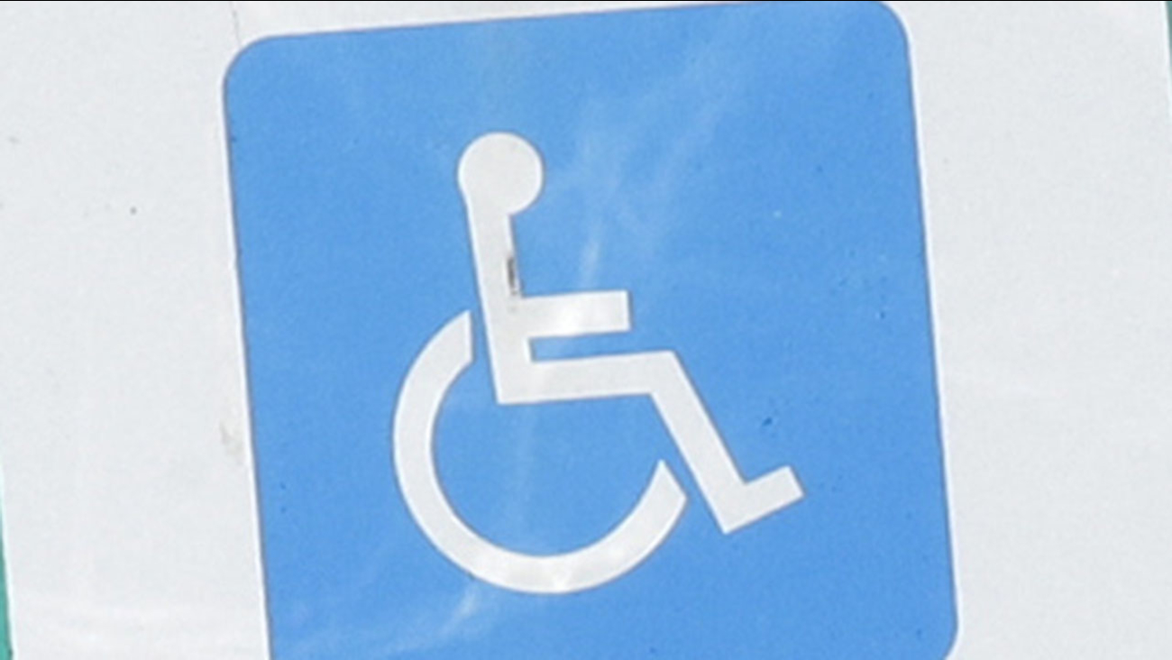 A handicapped parking sign