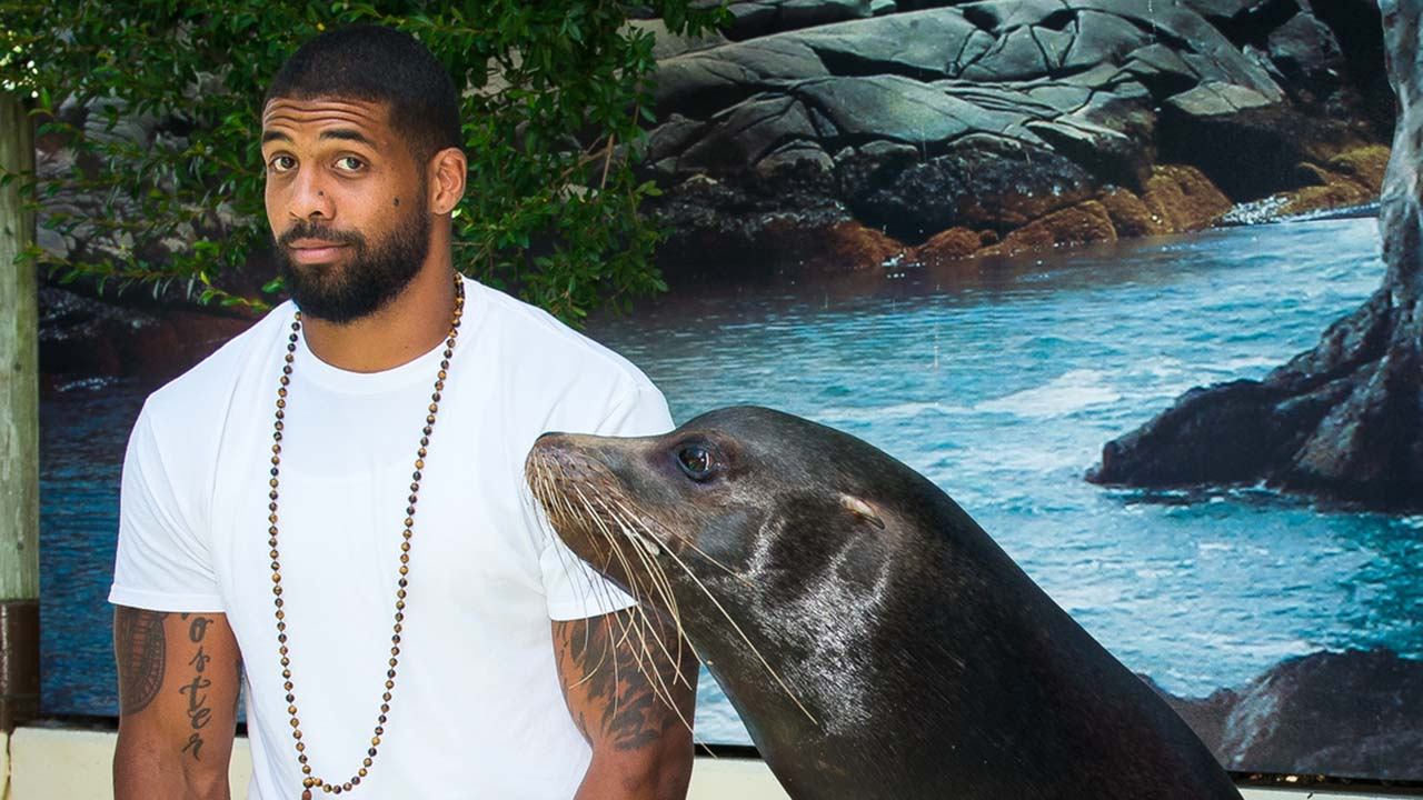 Arian Foster with Jonah the sea lion