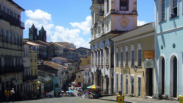 "<div class=""meta image-caption""><div class=""origin-logo origin-image ""><span></span></div><span class=""caption-text"">Salvador de Bahia: The ""City of the Holy Savior of the Bay of all Saints"" is known as Brazil's capital of happiness due to its countless popular outdoor parties. (anlopelope/Flickr)</span></div>"