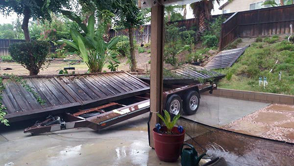 "<div class=""meta image-caption""><div class=""origin-logo origin-image none""><span>none</span></div><span class=""caption-text"">ABC7 viewer Lynette Lambert sent in this photo of a fallen fence after heavy rain in Riverside on Sunday, July 19, 2015. (KABC Photo)</span></div>"