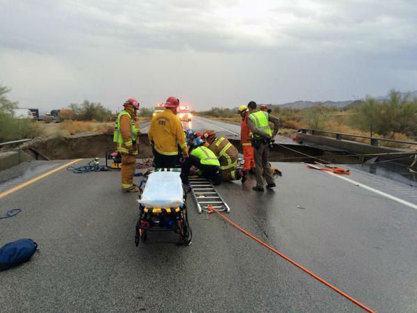 "<div class=""meta image-caption""><div class=""origin-logo origin-image none""><span>none</span></div><span class=""caption-text"">Firefighters extricate a truck driver after a bridge over the 10 Freeway at Desert Center collapses on Sunday, July 19, 2015. (Photo/John Hawkins)</span></div>"