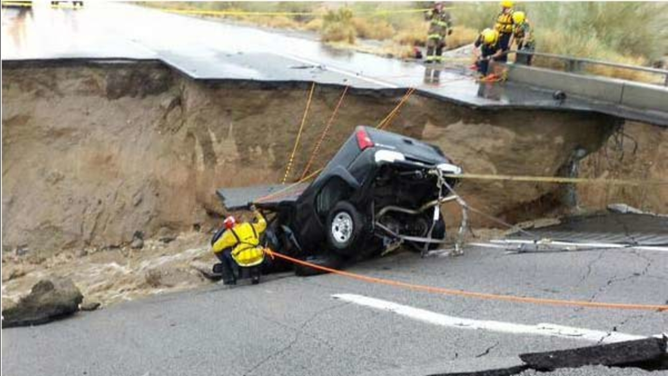 Firefighters extricate a truck driver after a bridge over the 10 Freeway at Desert Center collapses on Sunday, July 19, 2015.
