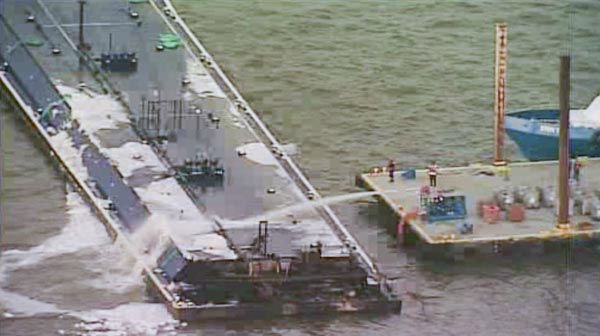 """<div class=""""meta image-caption""""><div class=""""origin-logo origin-image none""""><span>none</span></div><span class=""""caption-text"""">One of the barges, which is hauling petroleum naphtha, caught fire following the collision. An HFD fire boat put out those flames (KTRK Photo)</span></div>"""