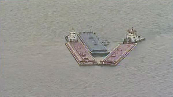 """<div class=""""meta image-caption""""><div class=""""origin-logo origin-image none""""><span>none</span></div><span class=""""caption-text"""">One of the barges, which is hauling petroleum naphtha, caught fire following the collision. An HFD fire boat put out those flames. (KTRK Photo)</span></div>"""