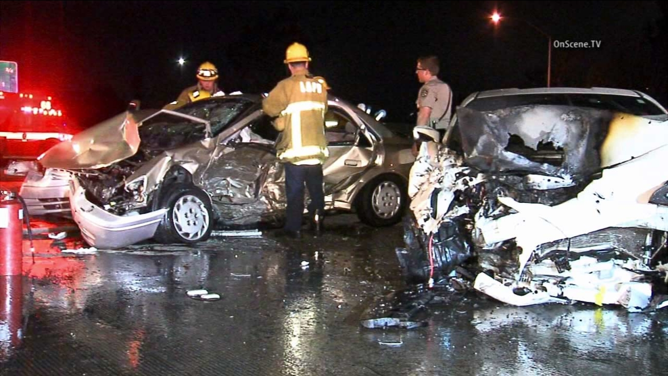 Emergency personnel provide aid at the scene of a fatal multi-vehicle crash on the eastbound 10 Freeway near La Brea Avenue in the Mid-City area on Monday, July 20, 2015.