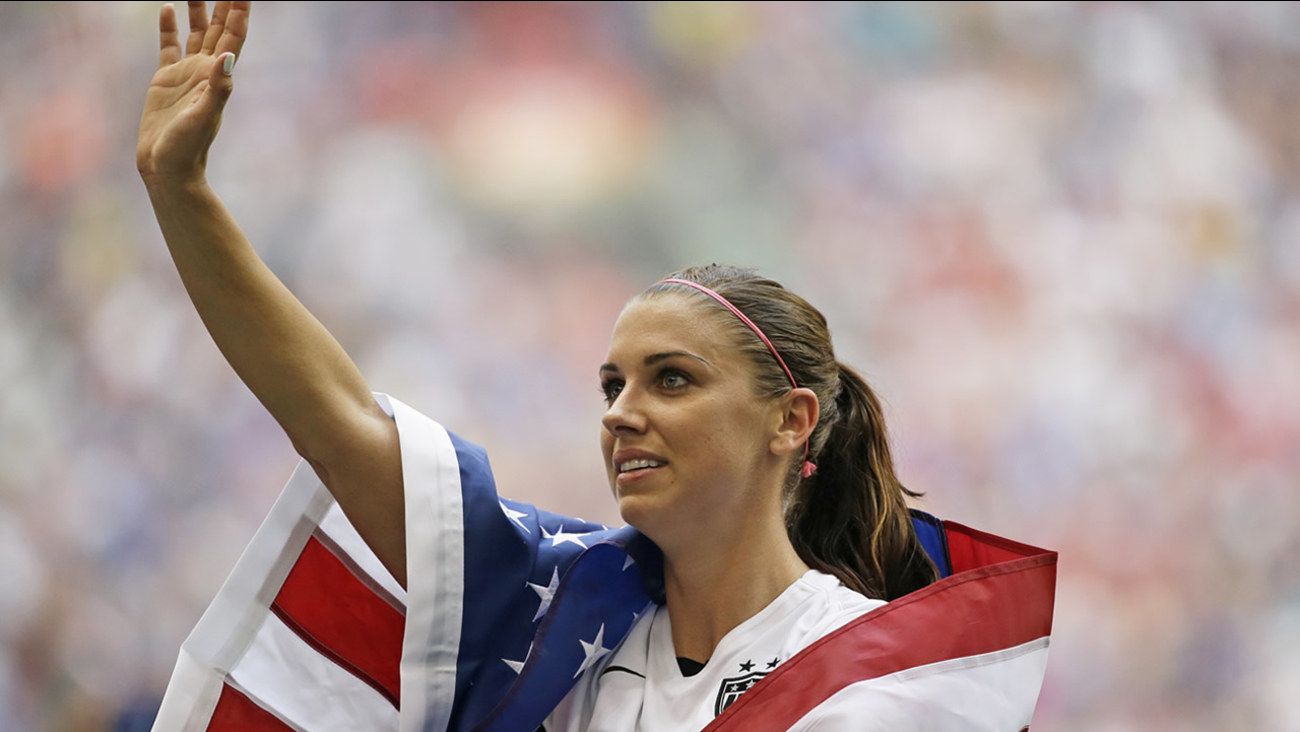 United States' Alex Morgan waves to fans after the U.S. beat Japan in the FIFA Women's World Cup soccer championship in Vancouver, British Columbia, Canada, July 5, 2015. (AP Photo/Elaine Thompson)