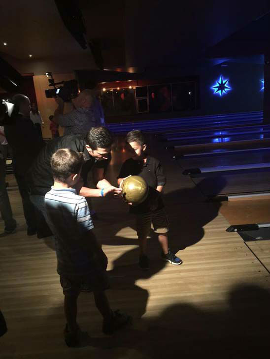 """<div class=""""meta image-caption""""><div class=""""origin-logo origin-image none""""><span>none</span></div><span class=""""caption-text"""">David Nuno bowling at a charity event with his kids (KTRK Photo)</span></div>"""