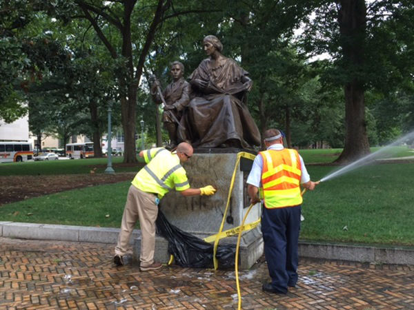 """<div class=""""meta image-caption""""><div class=""""origin-logo origin-image none""""><span>none</span></div><span class=""""caption-text""""><i>The Confederate monument that faces Morgan Street from Union Square at the State Capitol building was covered in black spray-paint.</i> (WTVD Photo/ Jim Schumacher)</span></div>"""