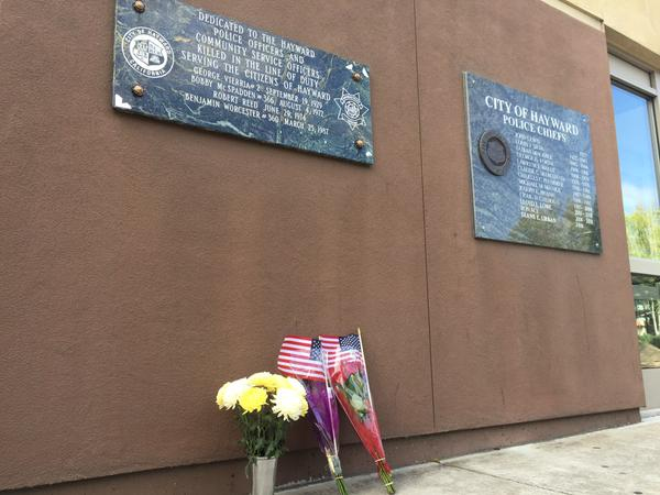 "<div class=""meta image-caption""><div class=""origin-logo origin-image none""><span>none</span></div><span class=""caption-text"">Candles and flowers were left at the Hayward Police Department to honor Sgt. Scott Lunger, who was shot and killed during a traffic stop in Hayward, Calif. on July 22, 2015. (KGO-TV/Katie Utehs)</span></div>"