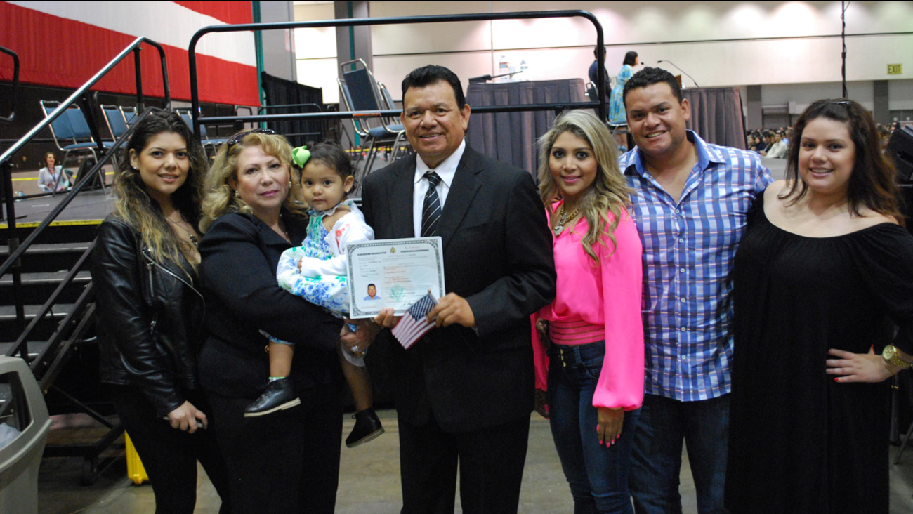 Former Los Angeles Dodgers pitcher Fernando Valenzuela holds his citizenship certificate and poses for a photo with his family on Wednesday, July 22, 2015.