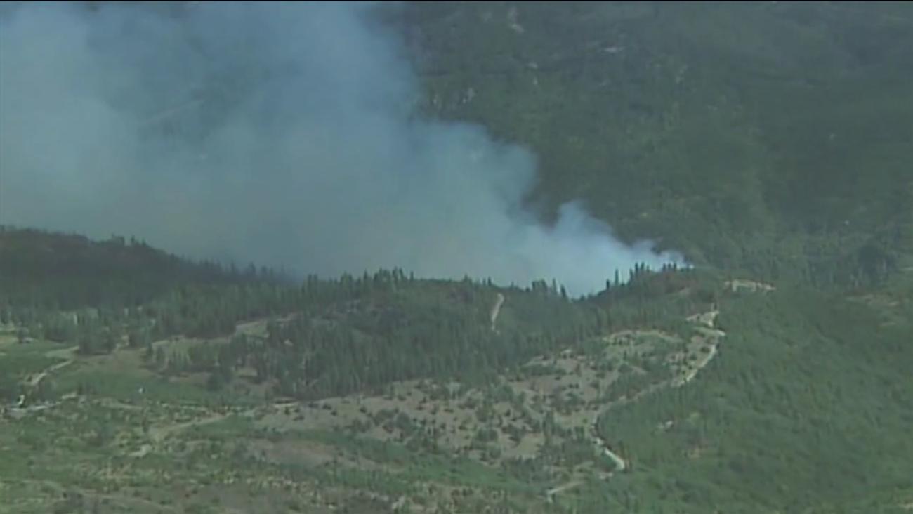 A fast-moving fire is burning in El Dorado County near Kyburz, July 23, 2015.