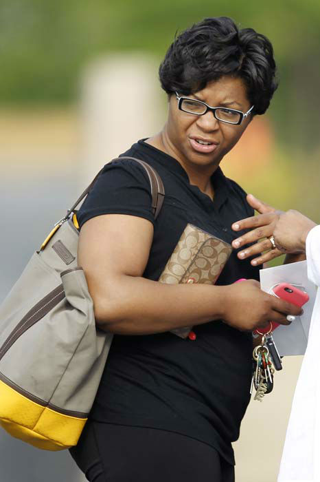 "<div class=""meta image-caption""><div class=""origin-logo origin-image none""><span>none</span></div><span class=""caption-text"">Sandra Bland's sister Sharon Cooper arrives at the DuPage African Methodist Episcopal Church Saturday, July 25, 2015, in Lisle, Ill. (Photo/Christian K. Lee)</span></div>"