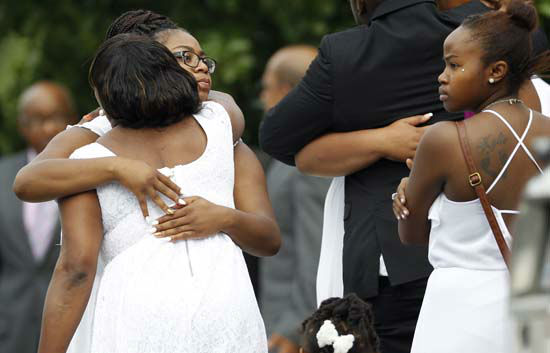 "<div class=""meta image-caption""><div class=""origin-logo origin-image none""><span>none</span></div><span class=""caption-text"">Mourners arrive at the DuPage African Methodist Episcopal Church Saturday, July 25, 2015, in Lisle, Ill. (AP Photo/ Christian K. Lee)</span></div>"