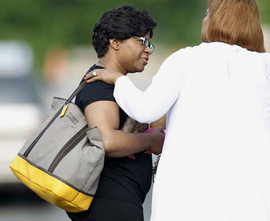 "<div class=""meta image-caption""><div class=""origin-logo origin-image none""><span>none</span></div><span class=""caption-text"">Sandra Bland's sister Sharon Cooper arrives at the wake service for Sandra Bland on Saturday, July 25, 2015, in Lisle, Ill. (AP Photo/ Christian K. Lee)</span></div>"