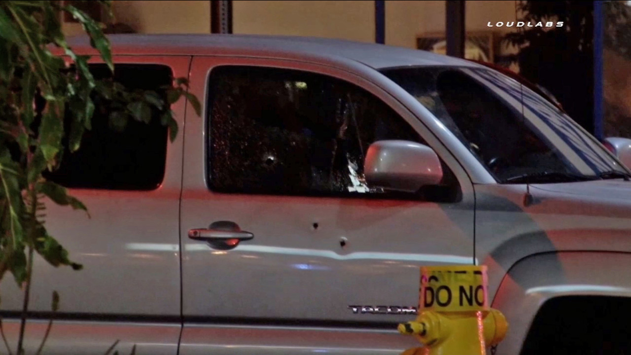 The victim's truck is shown with bullet holes in the passenger side door and window on Friday, July 24, 2015.