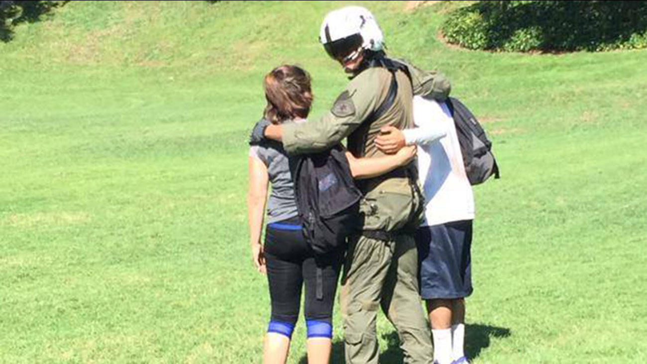 An image released by the Los Angeles County Sheriff's Office shows the couple and an emergency responder